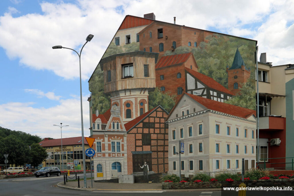 Mural z charakterystycznymi zabytkami Czarnkowa zlokalizowany przy Placu Pułkownika Bartoszka